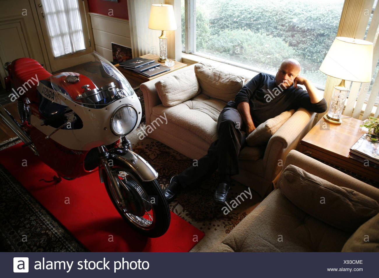 A collector in his living room and one a vintage motorcycle ...