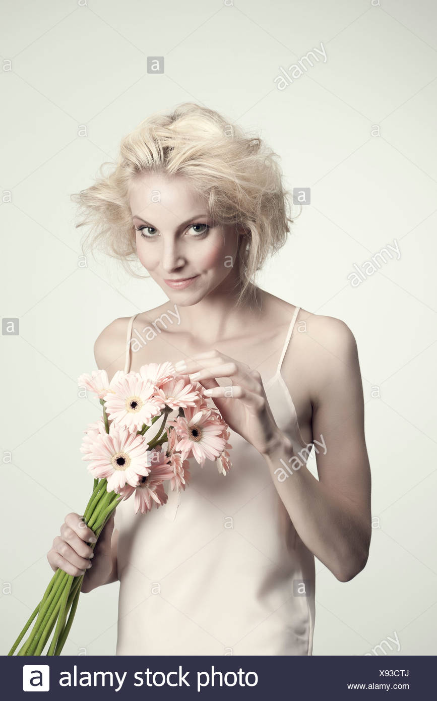 Young woman holding bunch of gerbera daisies Stock Photo