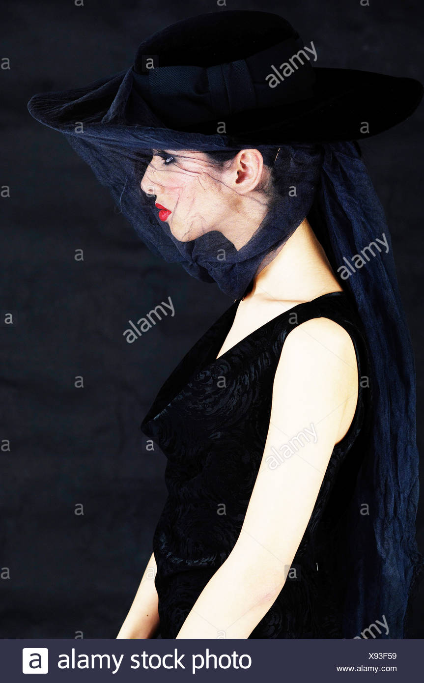 Young woman wearing black and a veil, widow Stock Photo