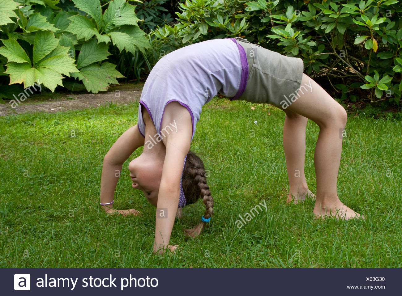 sport sports sporty athletic wiry pithy heavyset tight sporting yoga mobile blond girl girls child children kids healthy plait - Stock Image