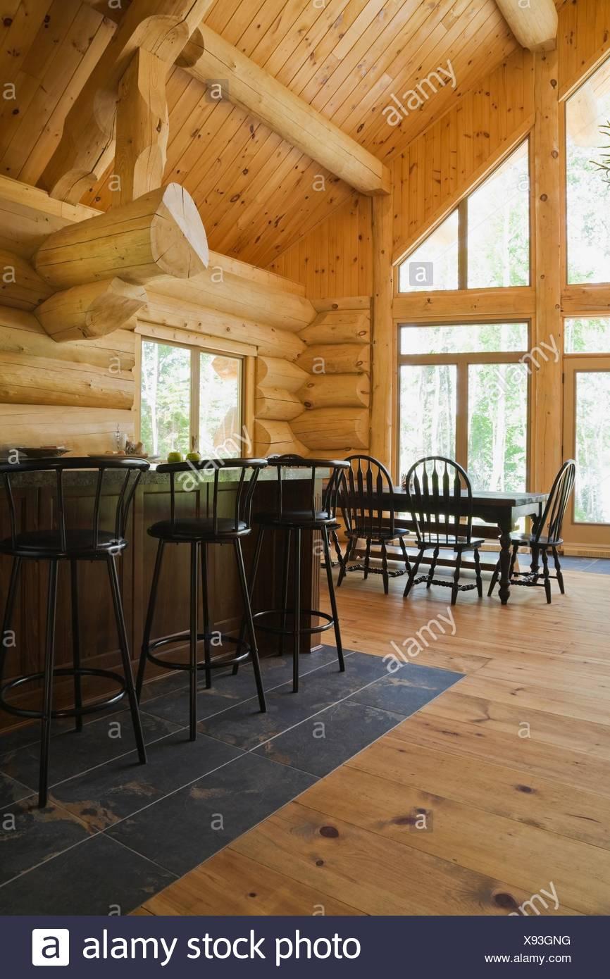 Awe Inspiring Bar Stools At Breakfast Bar On Tiled Floor In Eastern White Evergreenethics Interior Chair Design Evergreenethicsorg