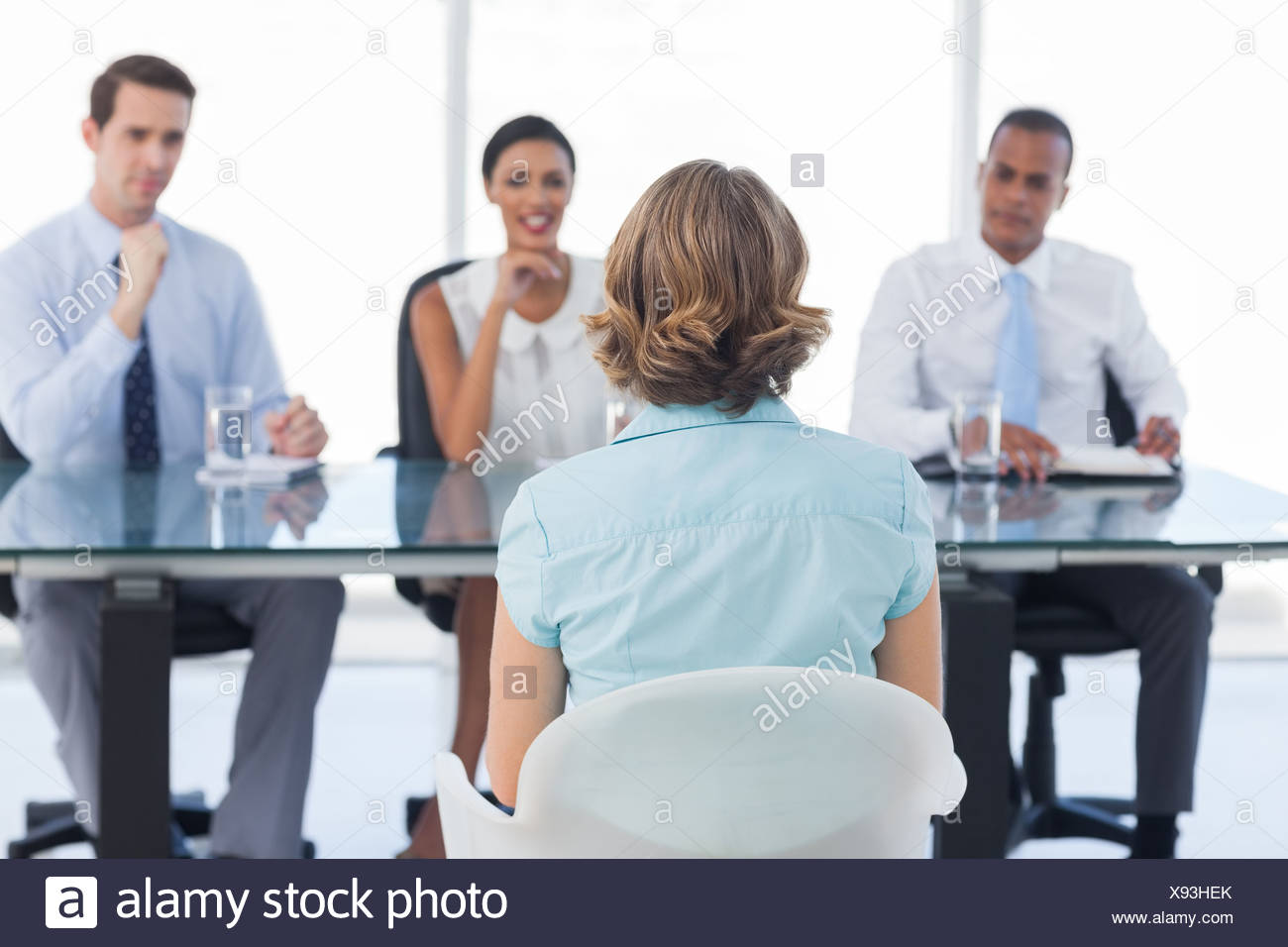 Female applicant sitting during a job interview - Stock Image