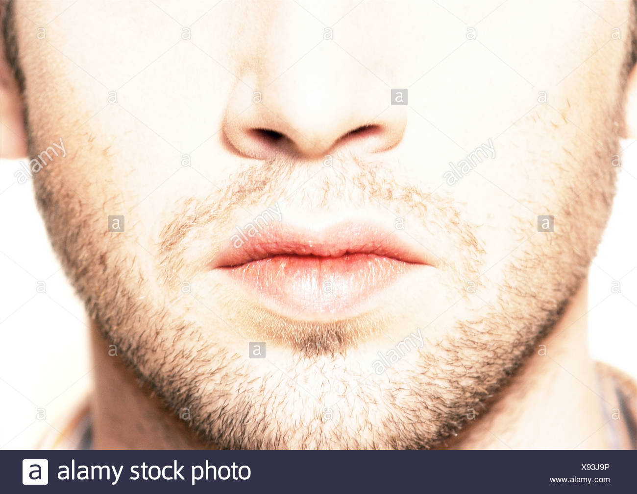 Lower part of man's face, close-up - Stock Image