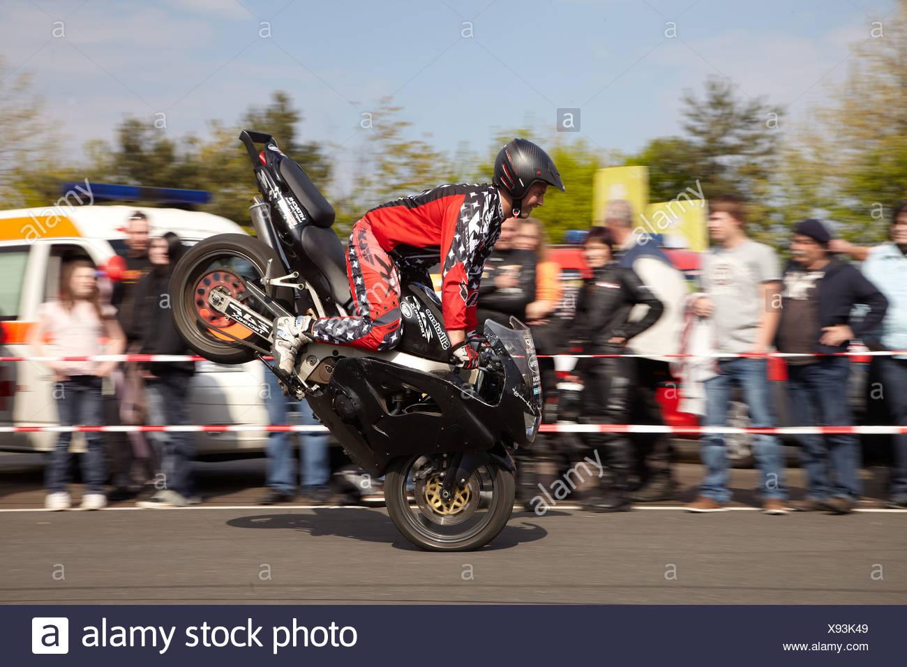 Motorcycle stuntman Mike Auffenberg showing a stoppy, Koblenz, Rhineland-Palatinate, Germany, Europe - Stock Image