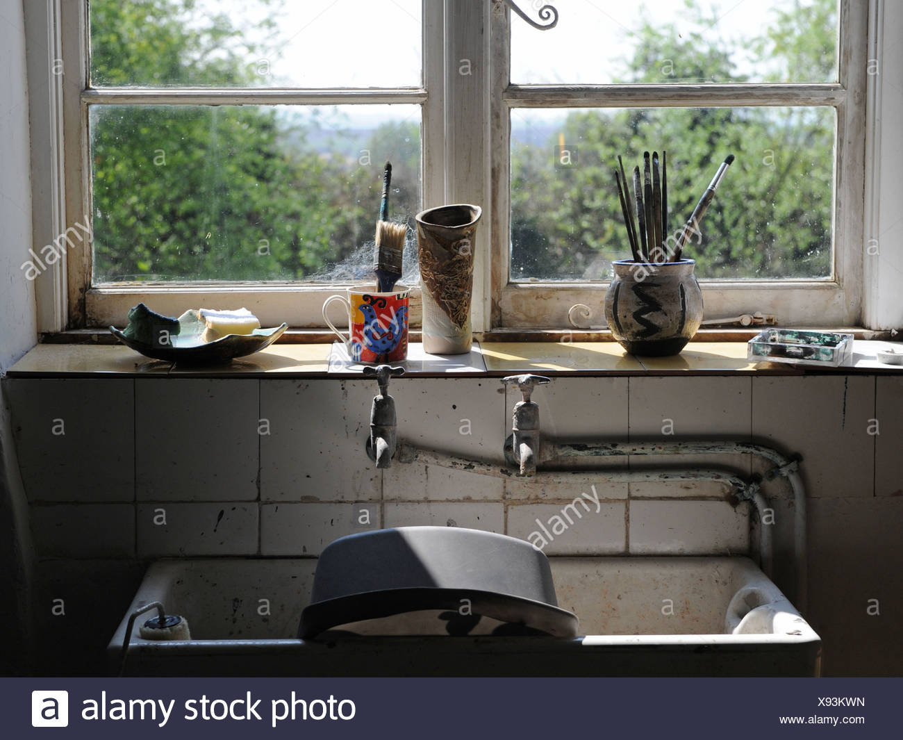 The sink area of a struggling artist - Stock Image
