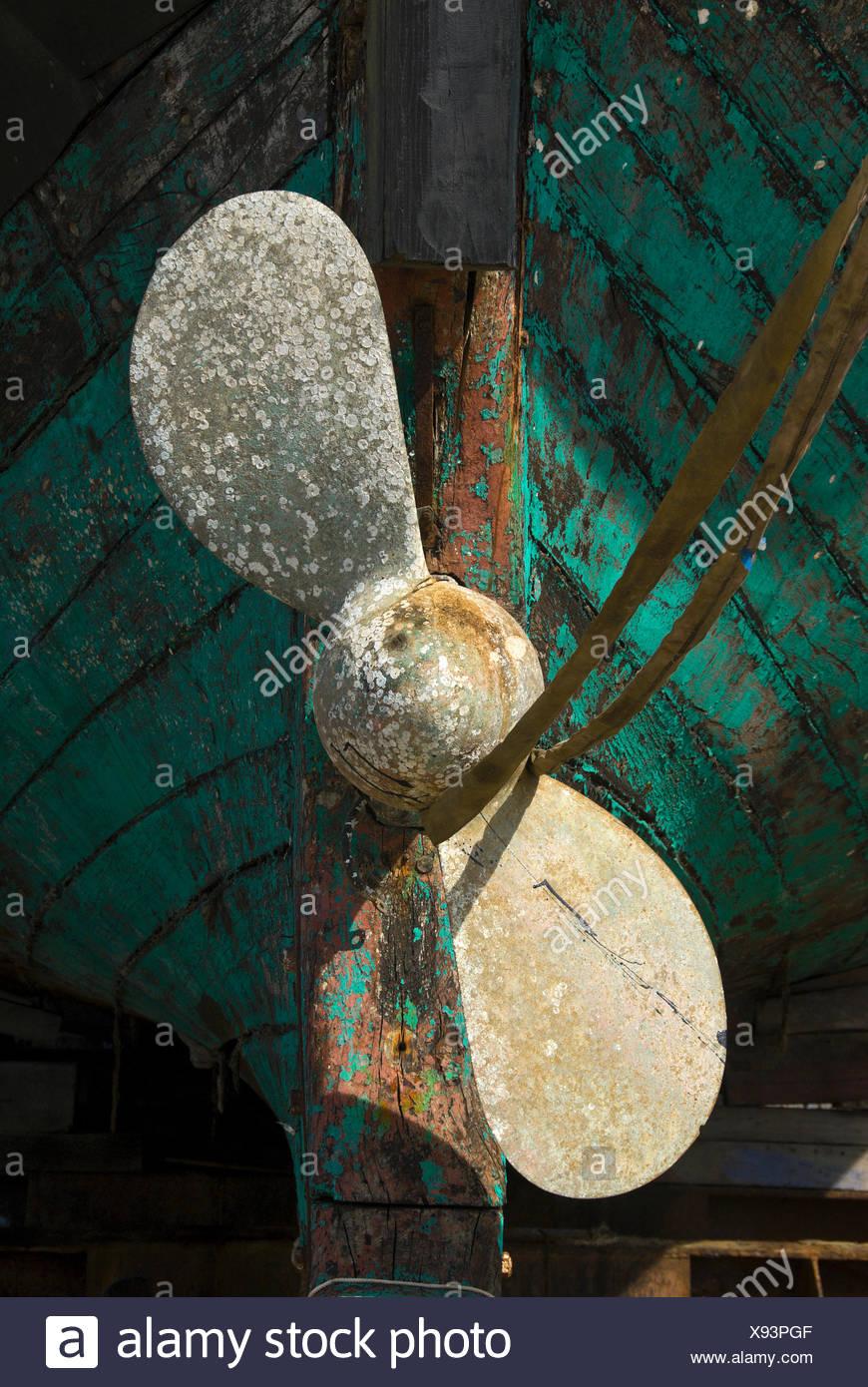 Ship propeller on an old fishing boat in dry dock, port of Hvide Sande, Denmark, Europe - Stock Image