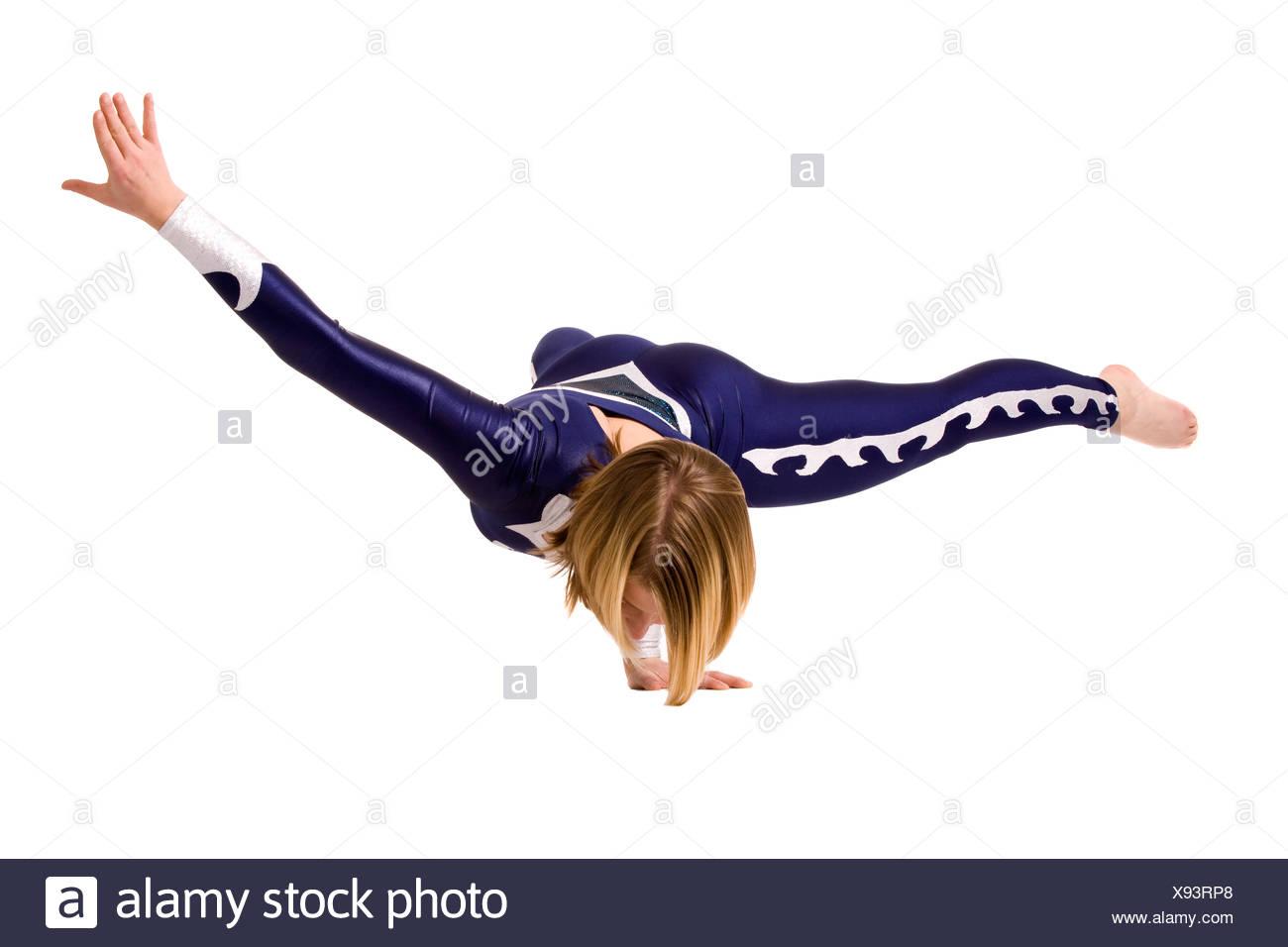 Balancing on one hand - Stock Image
