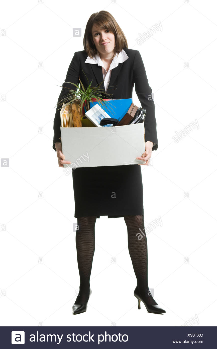 businessperson clearing out things - Stock Image