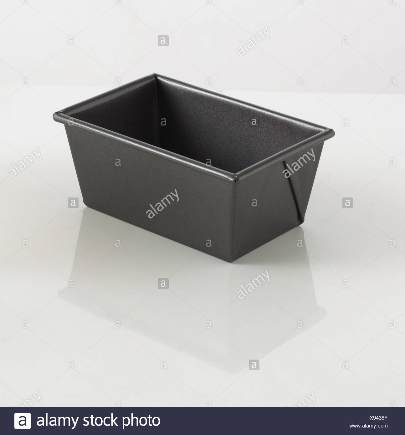 Black loaf pan on white background - Stock Image