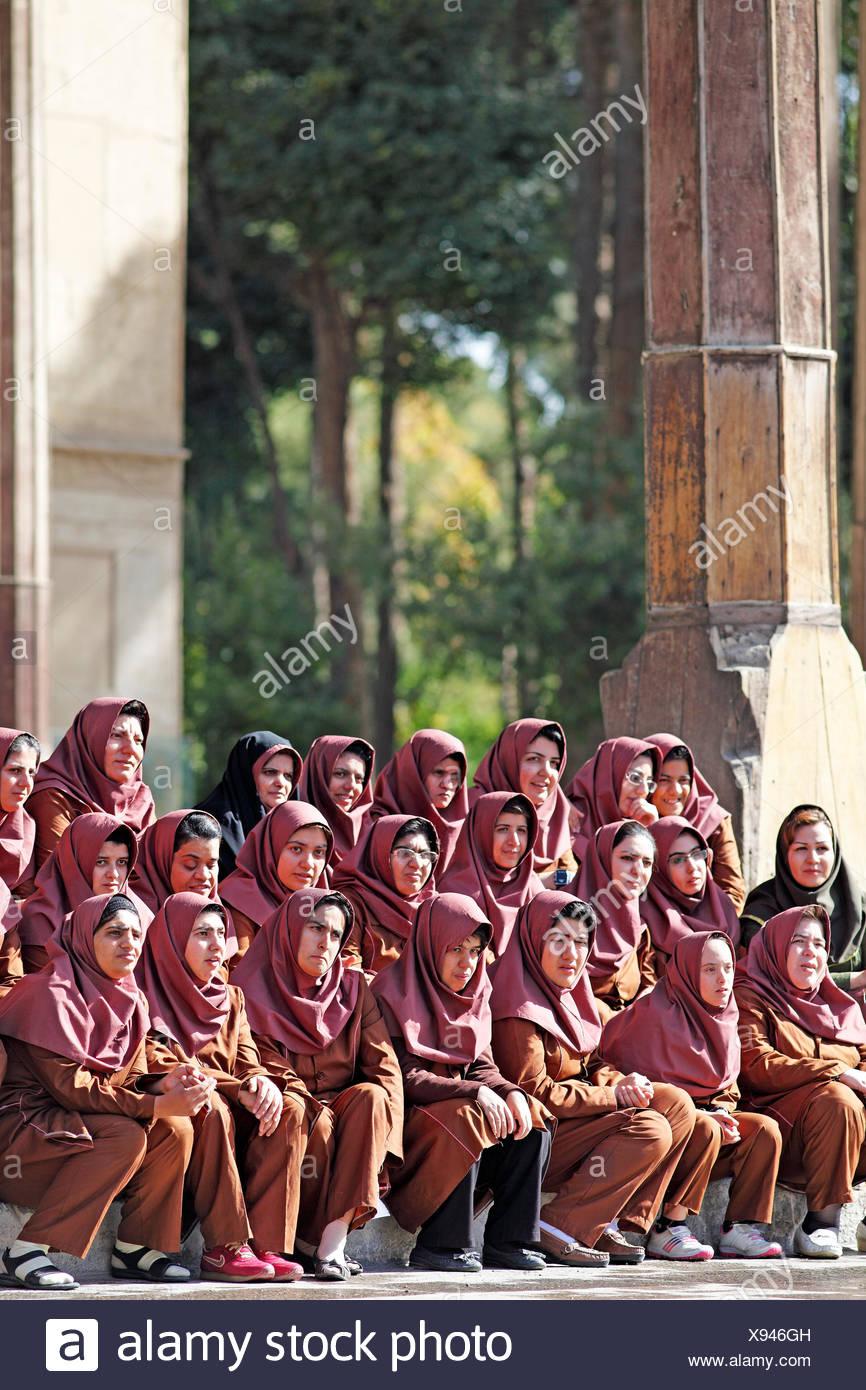 Iranian girls posing for a class photo wearing uniforms, disabled girls and women, Chehel Sotun Palace Garden, Isfahan - Stock Image