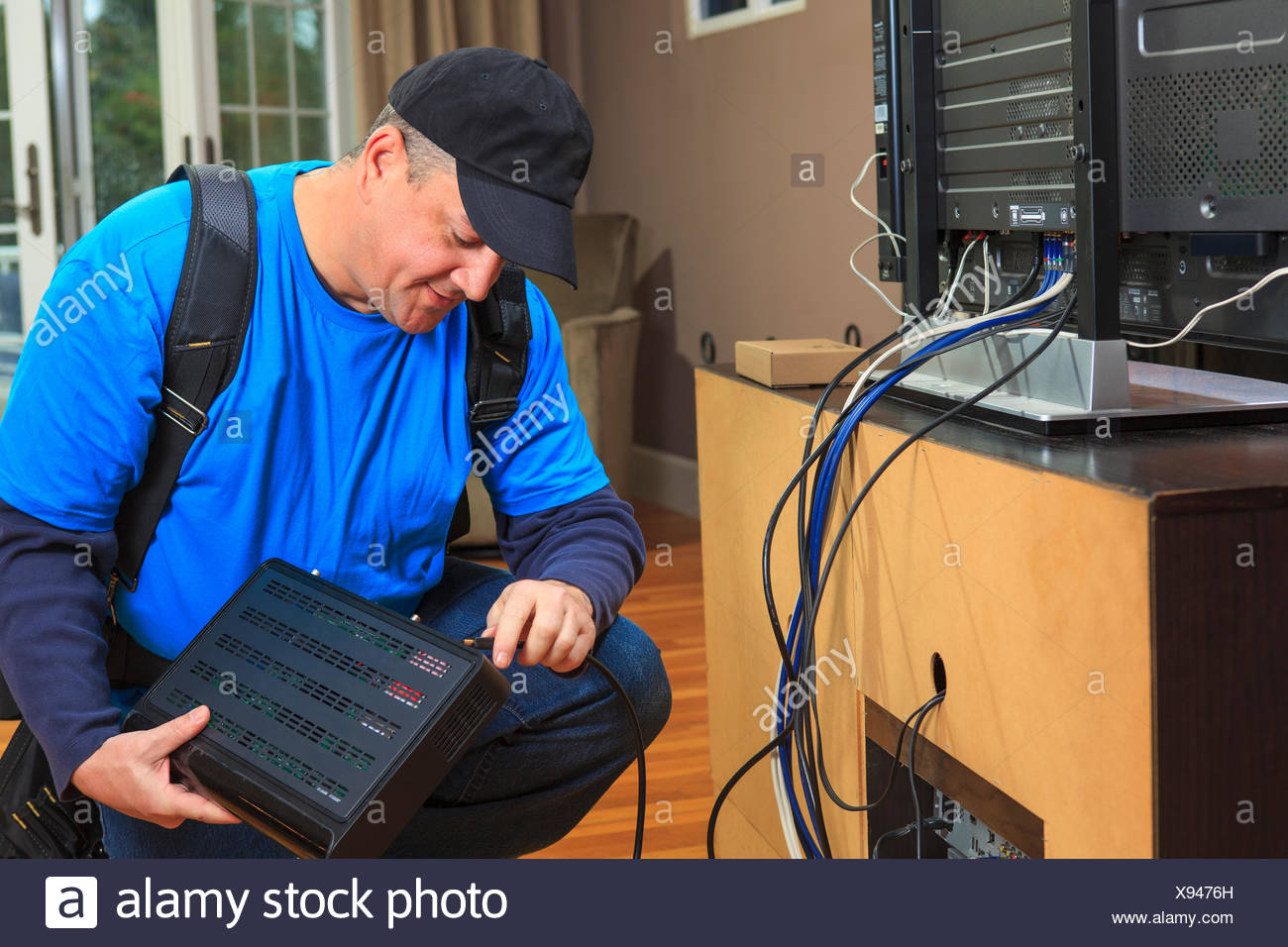 Awe Inspiring Service Man Connecting Cable To Modem Box For Home Tv Stock Photo Wiring Digital Resources Hutpapmognl