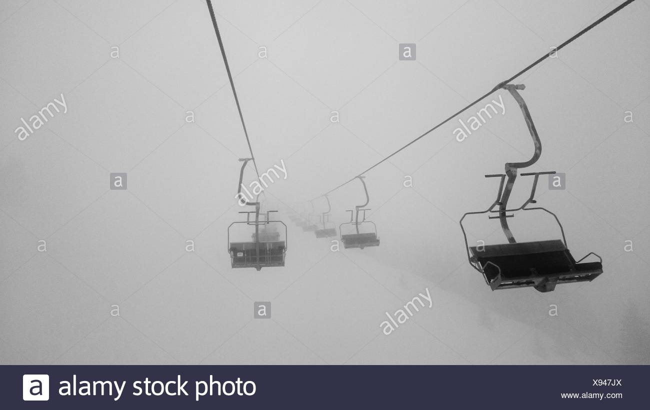 Silhouette Of Ski Lift In Fog - Stock Image