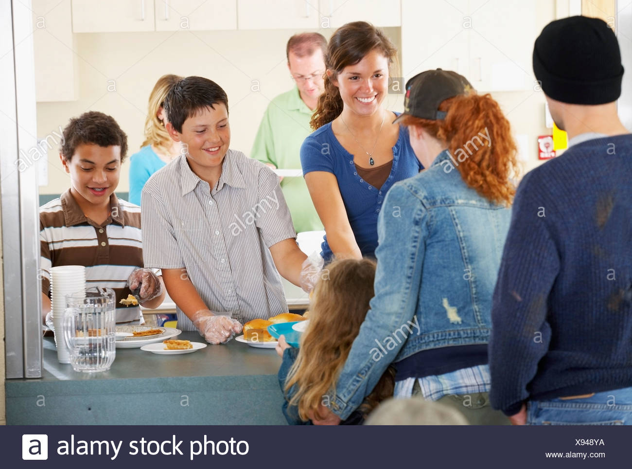 Group Of People At Community Buffet - Stock Image