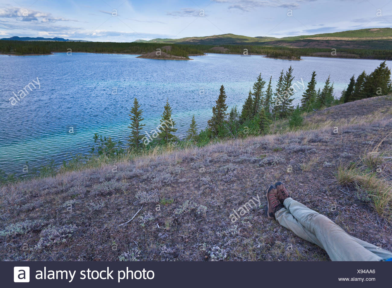 Hiker taking a rest - Stock Image