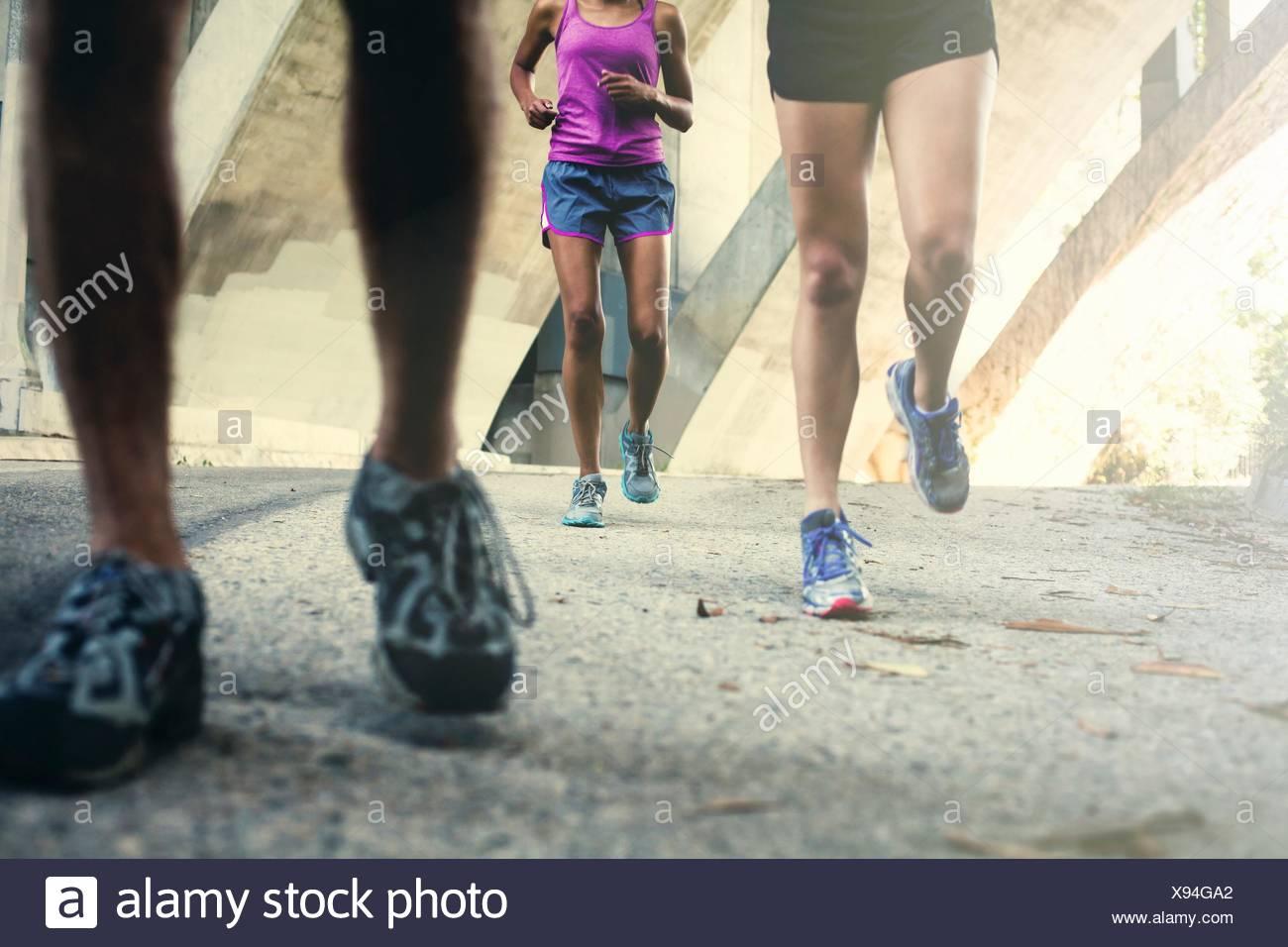 Joggers running on bridge - Stock Image