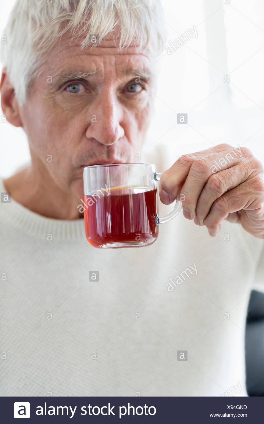 Senior man enjoying cup of green tea - Stock Image