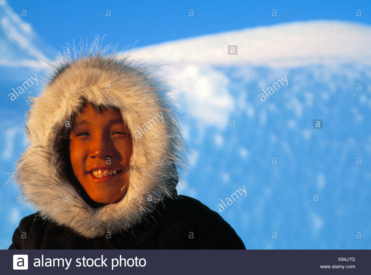 bff9d3fb4d7 Inuit Eskimo boy in front of ice berg Canada - Stock Image