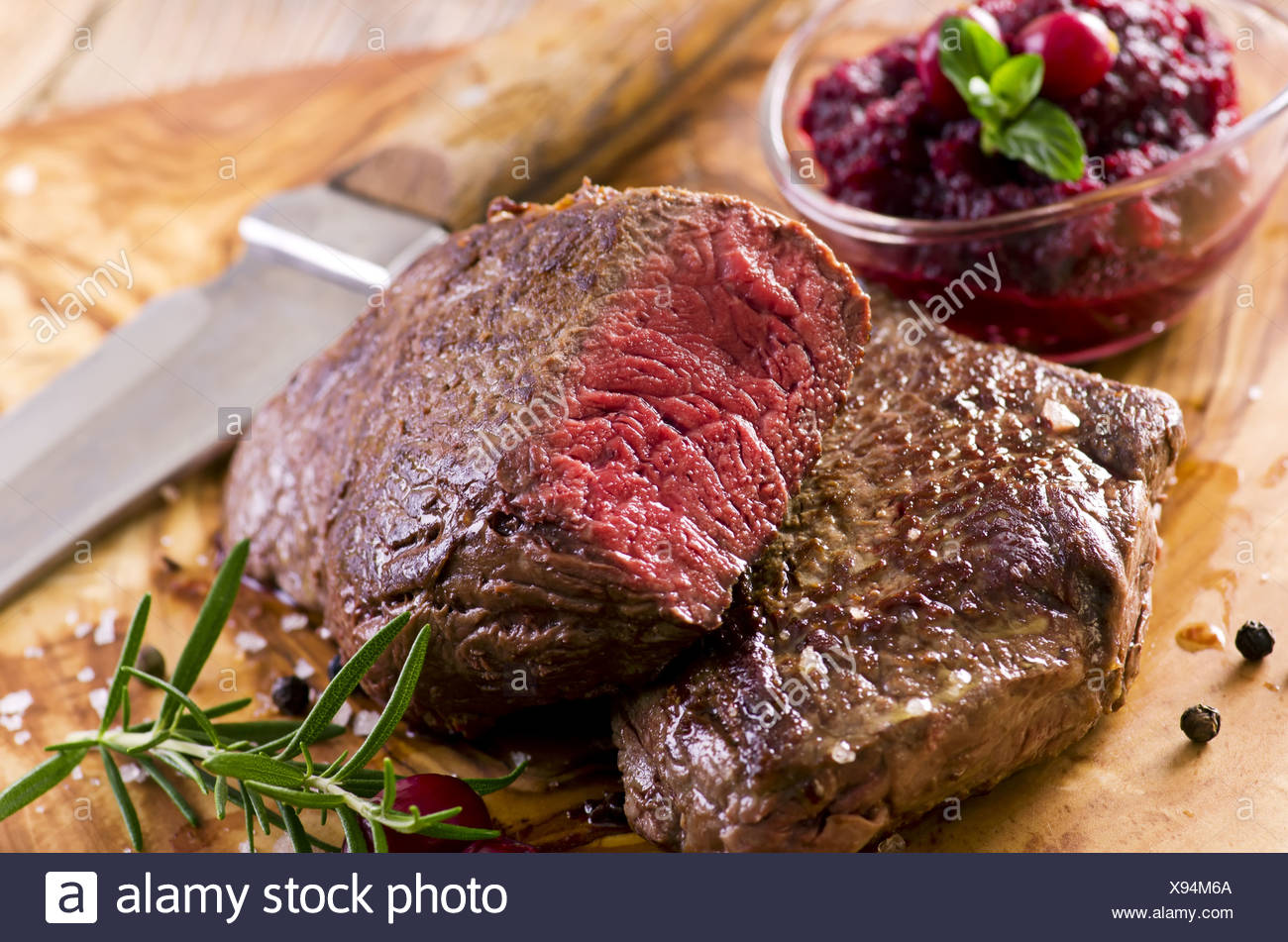 beef steaks on the wooden board Stock Photo