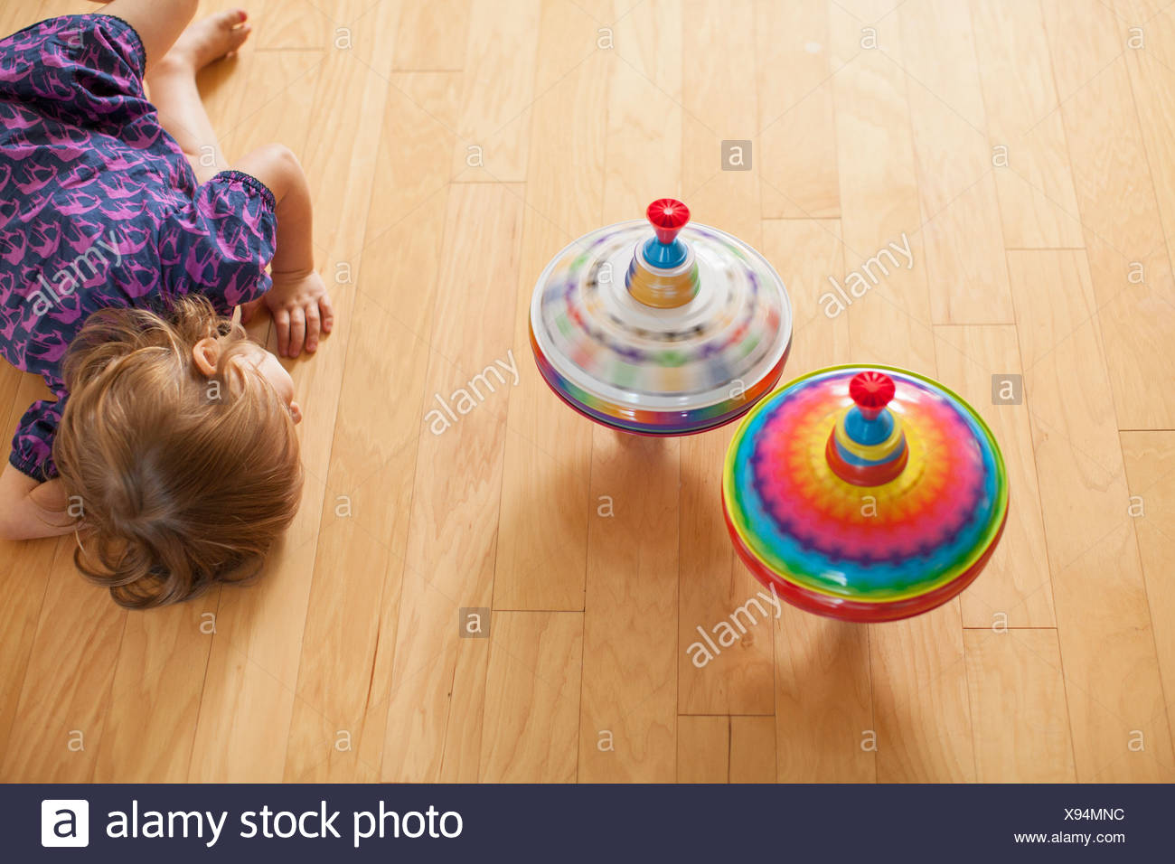 Girl playing with spinning tops Stock Photo: 281001880 - Alamy