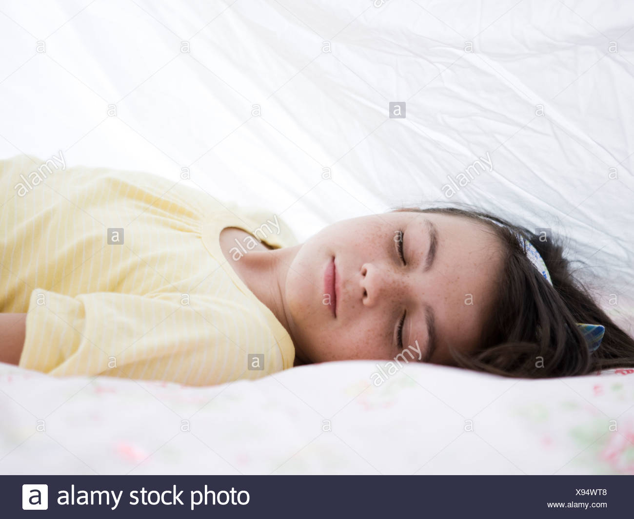girl under a blanket - Stock Image