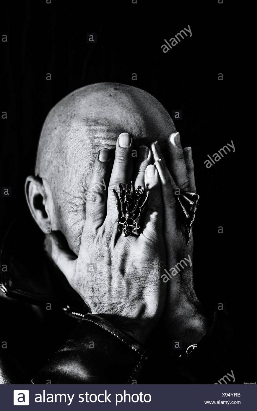 Bald Man Covering Face With Hands - Stock Image