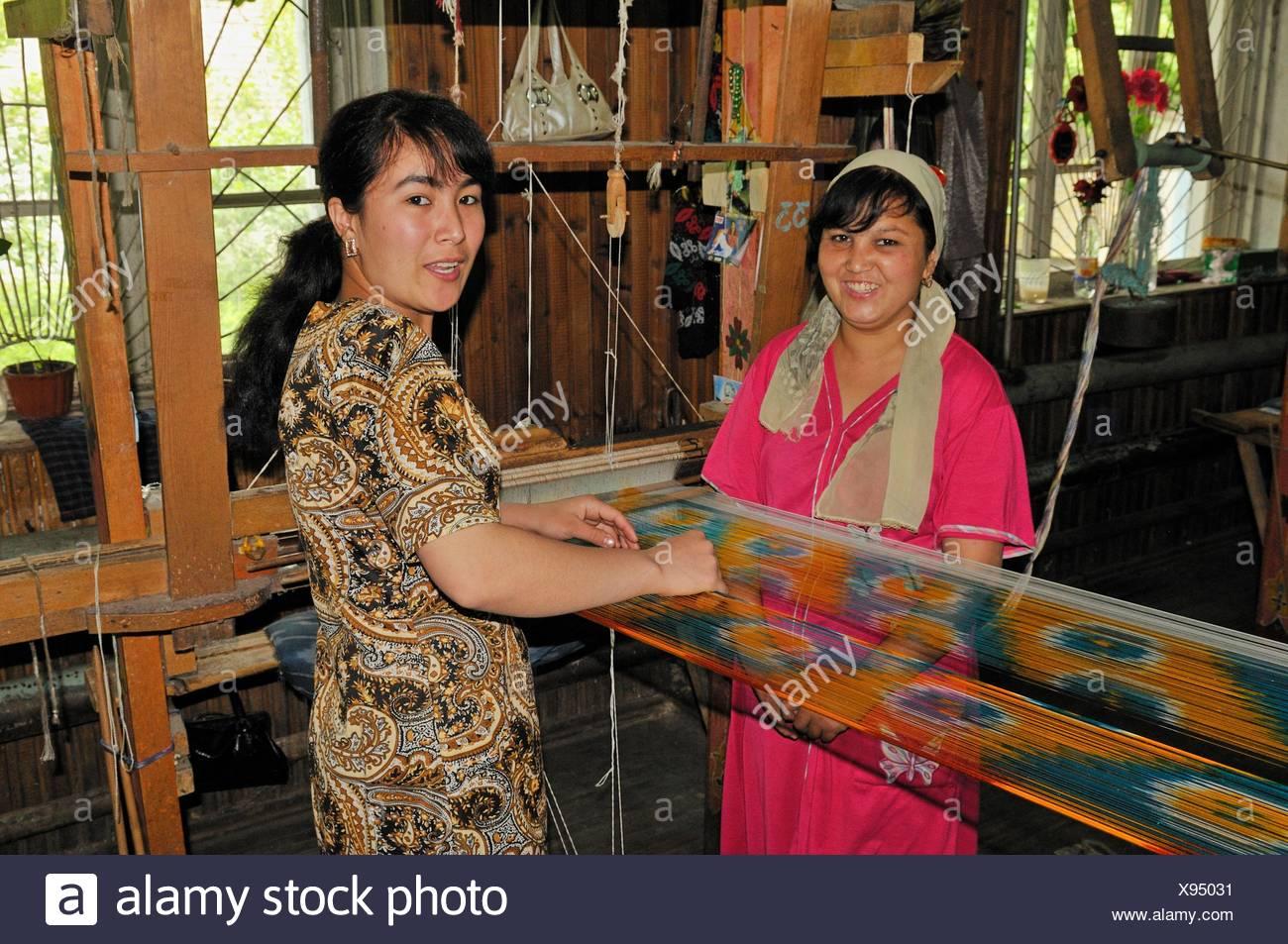 silk production, usbek woman working on a wooden loom, Silk Road, Fergana Valley, Uzbekistan, Central Asia Stock Photo