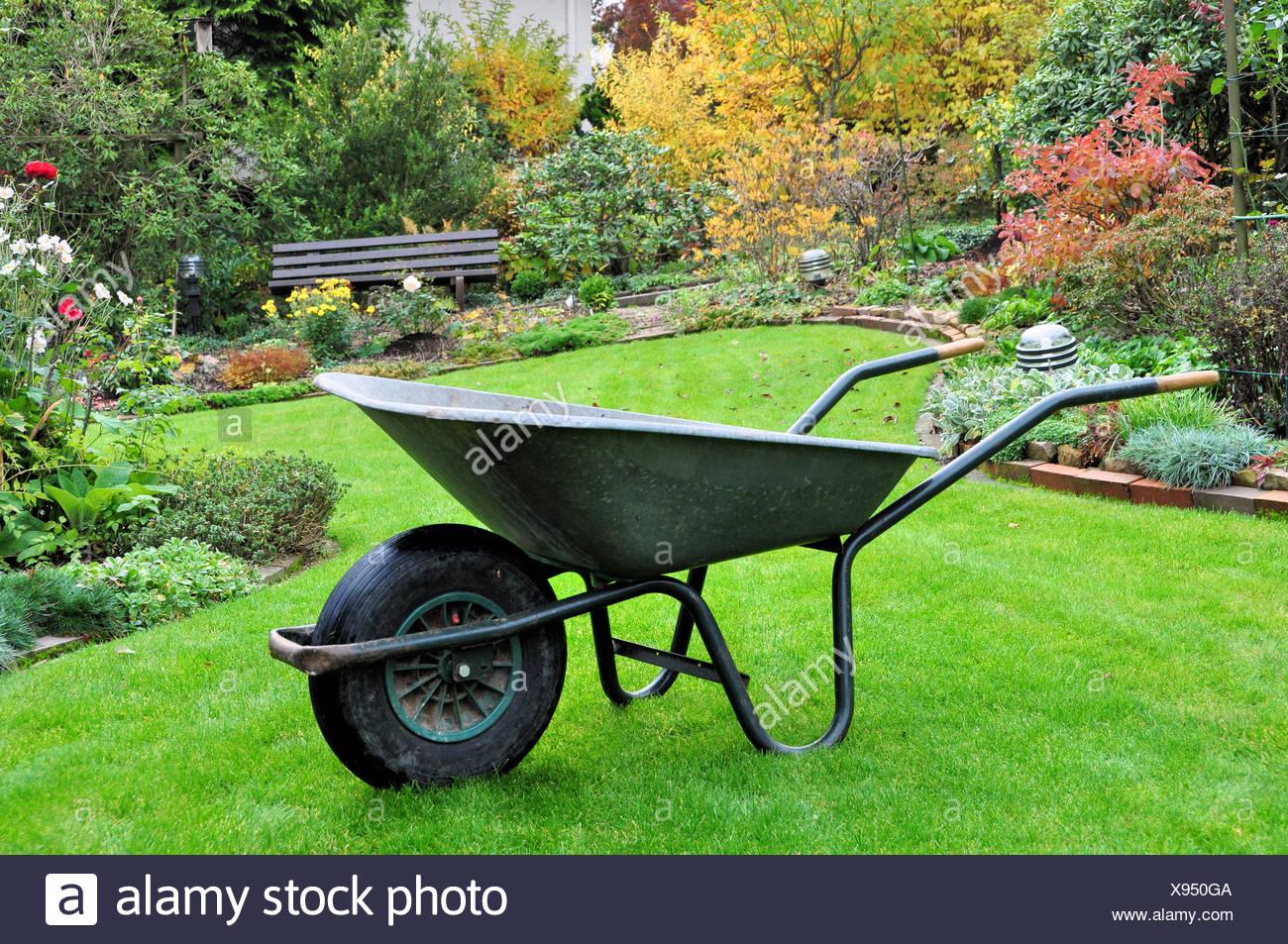 garden cart in autumnal garden Stock Photo