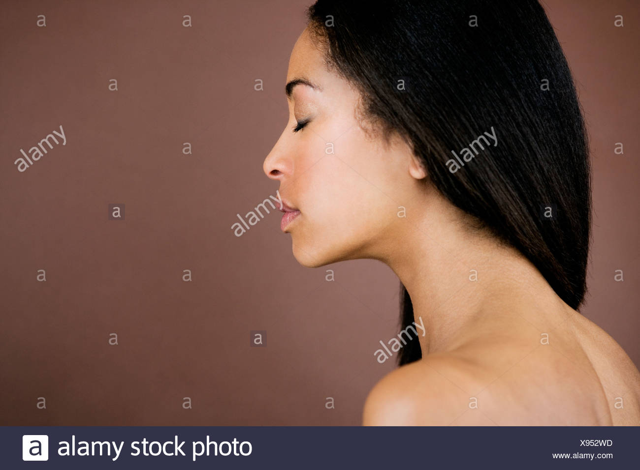 A portrait of a young black woman, side view - Stock Image