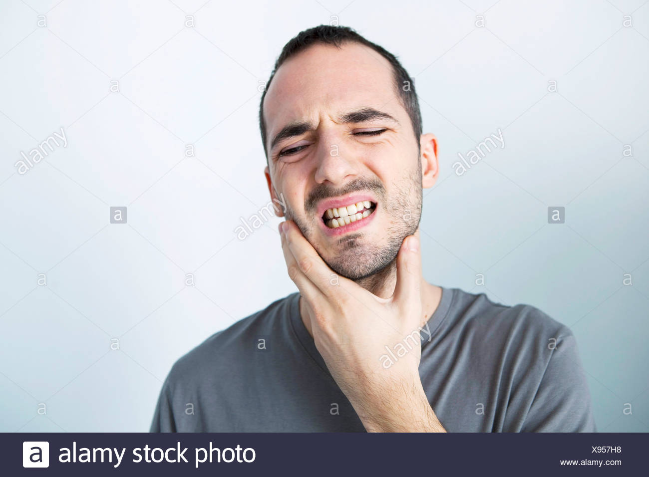 MAN WITH TOOTHACHE - Stock Image