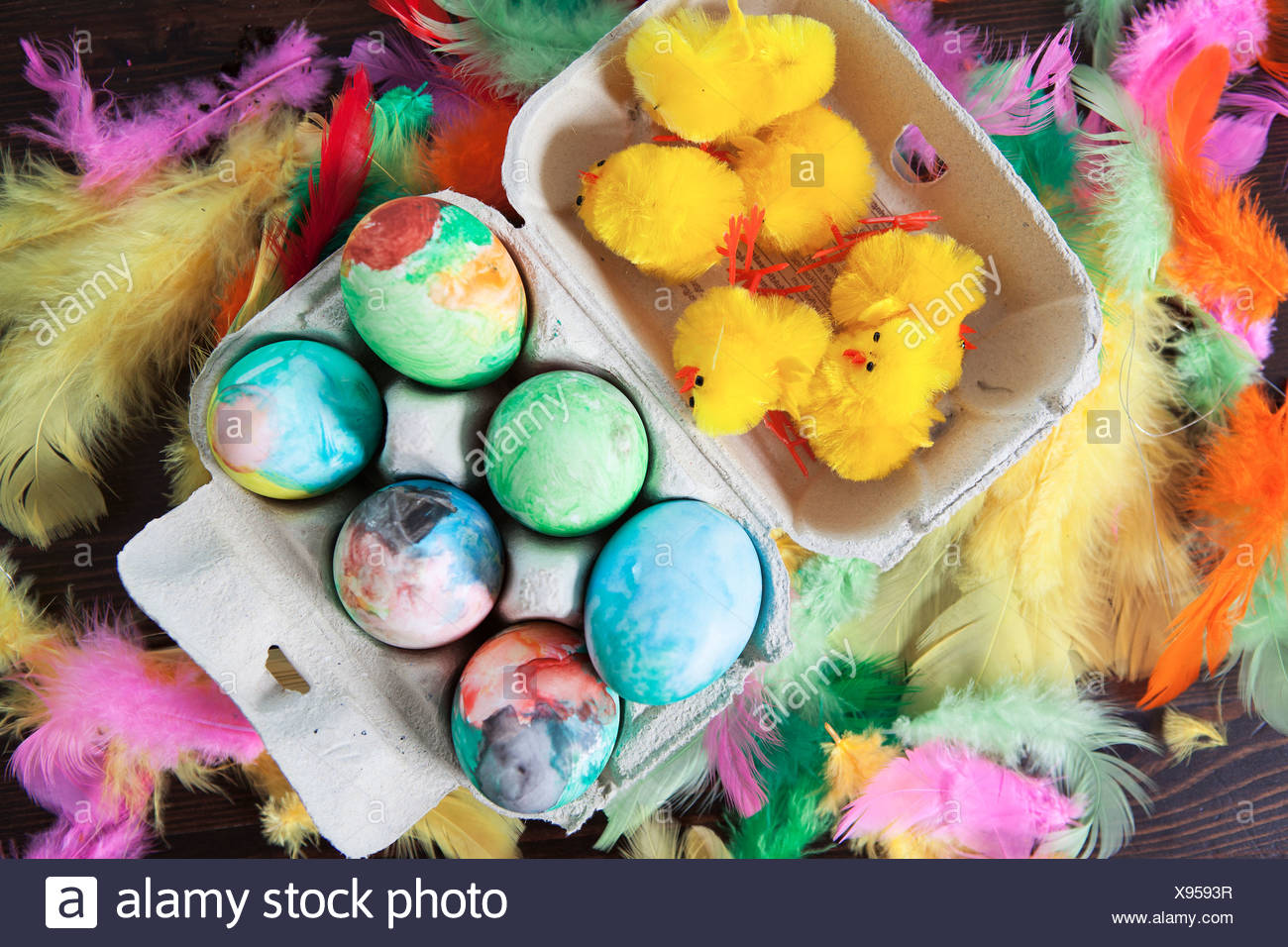 Elevated view of painted Easter eggs and baby chickens - Stock Image