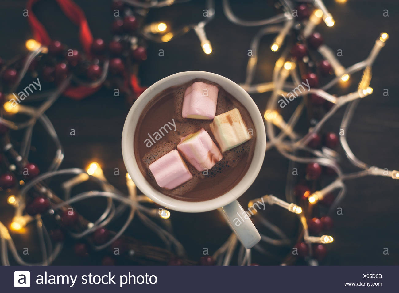 Close-Up Of Marshmallows In Coffees On Table Surrounded With Lighting - Stock Image