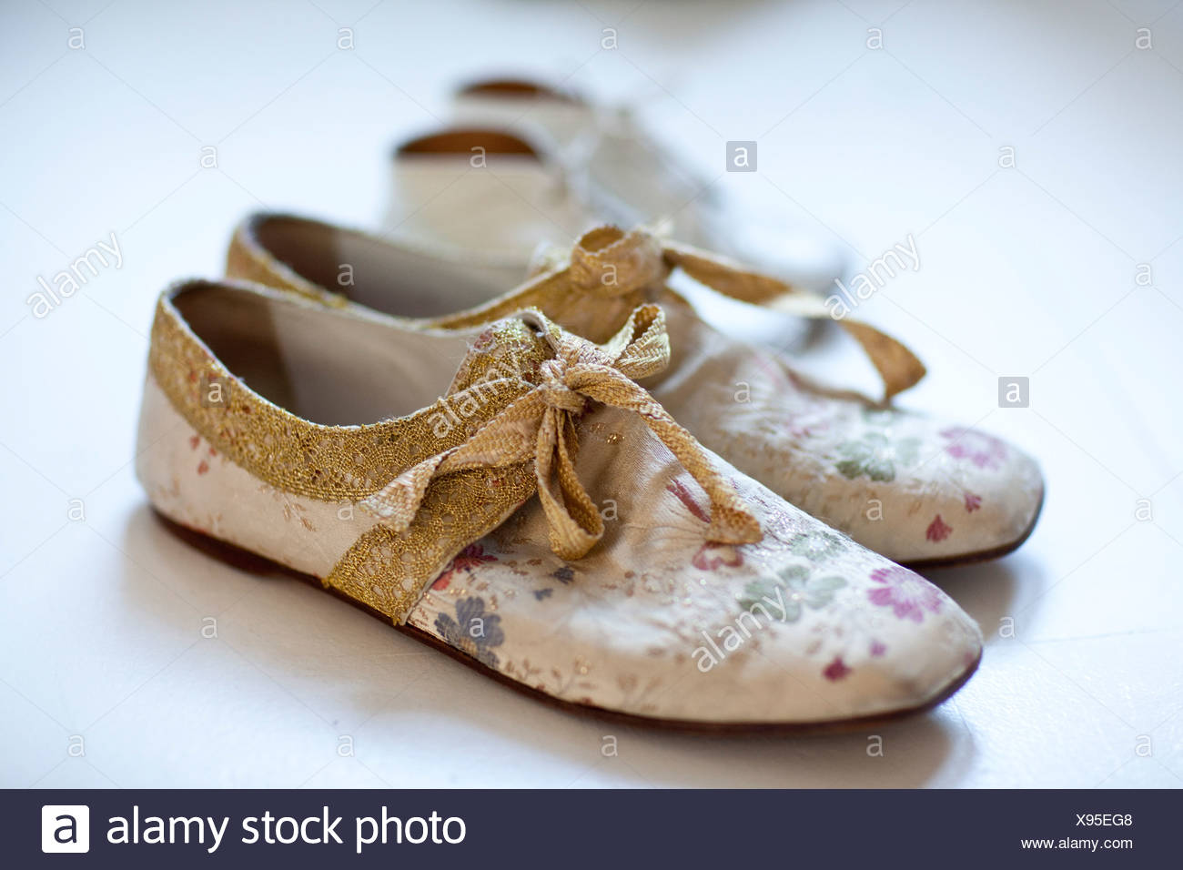 Close up of flower patterned shoes - Stock Image