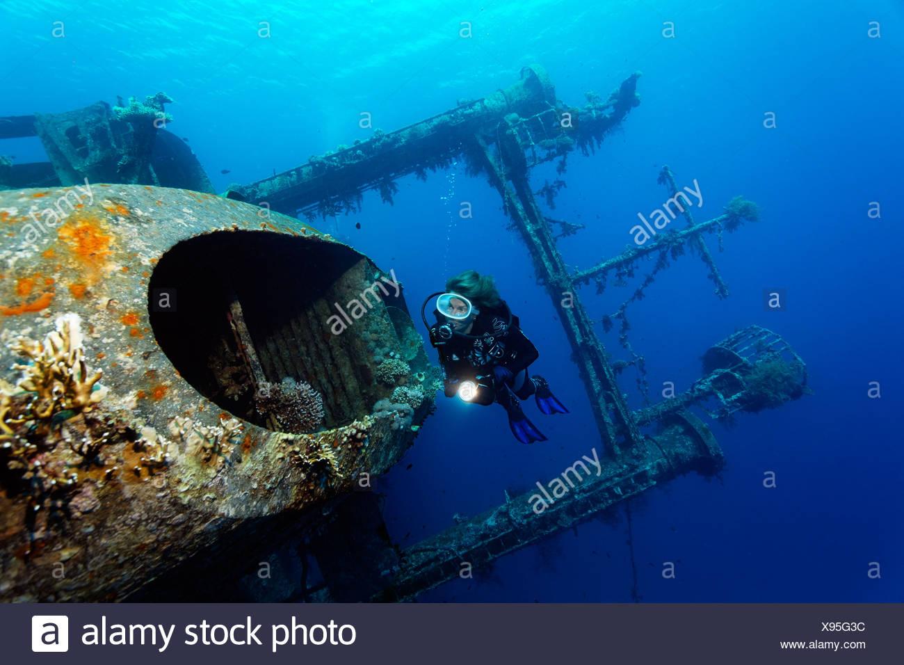 Diver at chimney, shipwreck, Cedar Pride, Red Sea, Hashemite Kingdom of Jordan, Western Asia - Stock Image