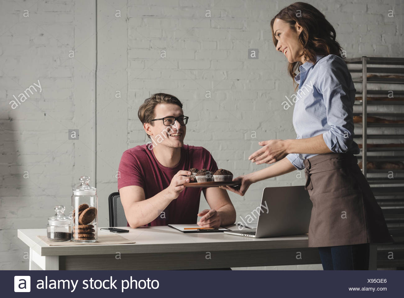 Bakers examining pastries - Stock Image