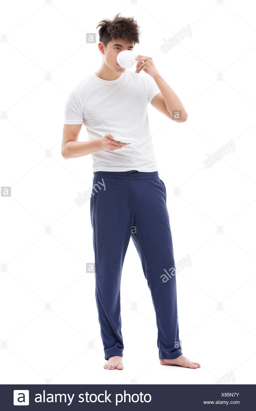 Young man drinking coffee in the morning - Stock Image