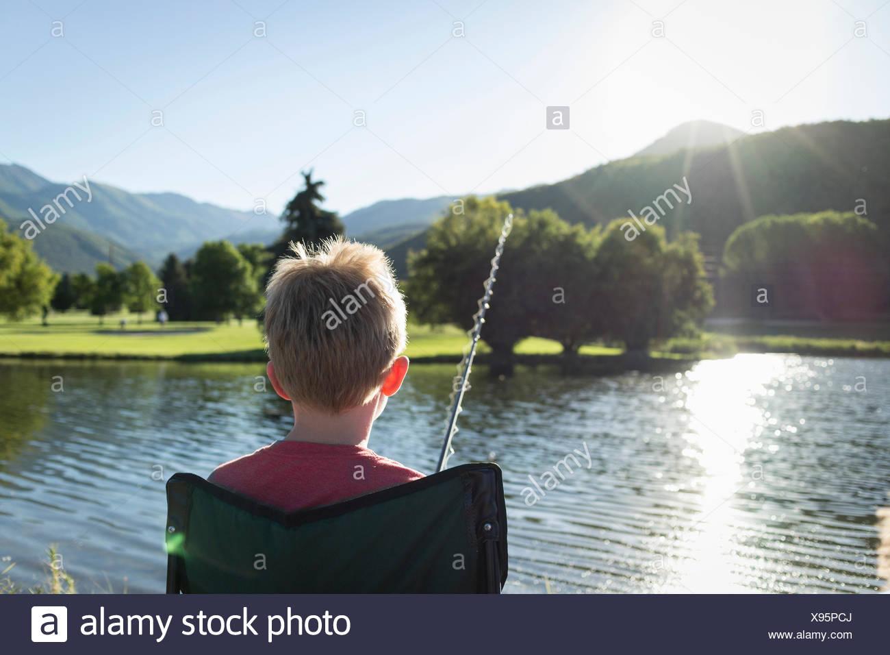 Young boy fishing, rear view, Washington State Park, Utah, USA - Stock Image