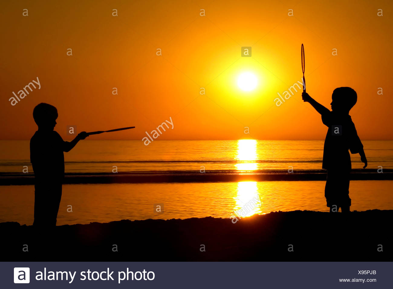 Playing Tennis With The Sun - Stock Image