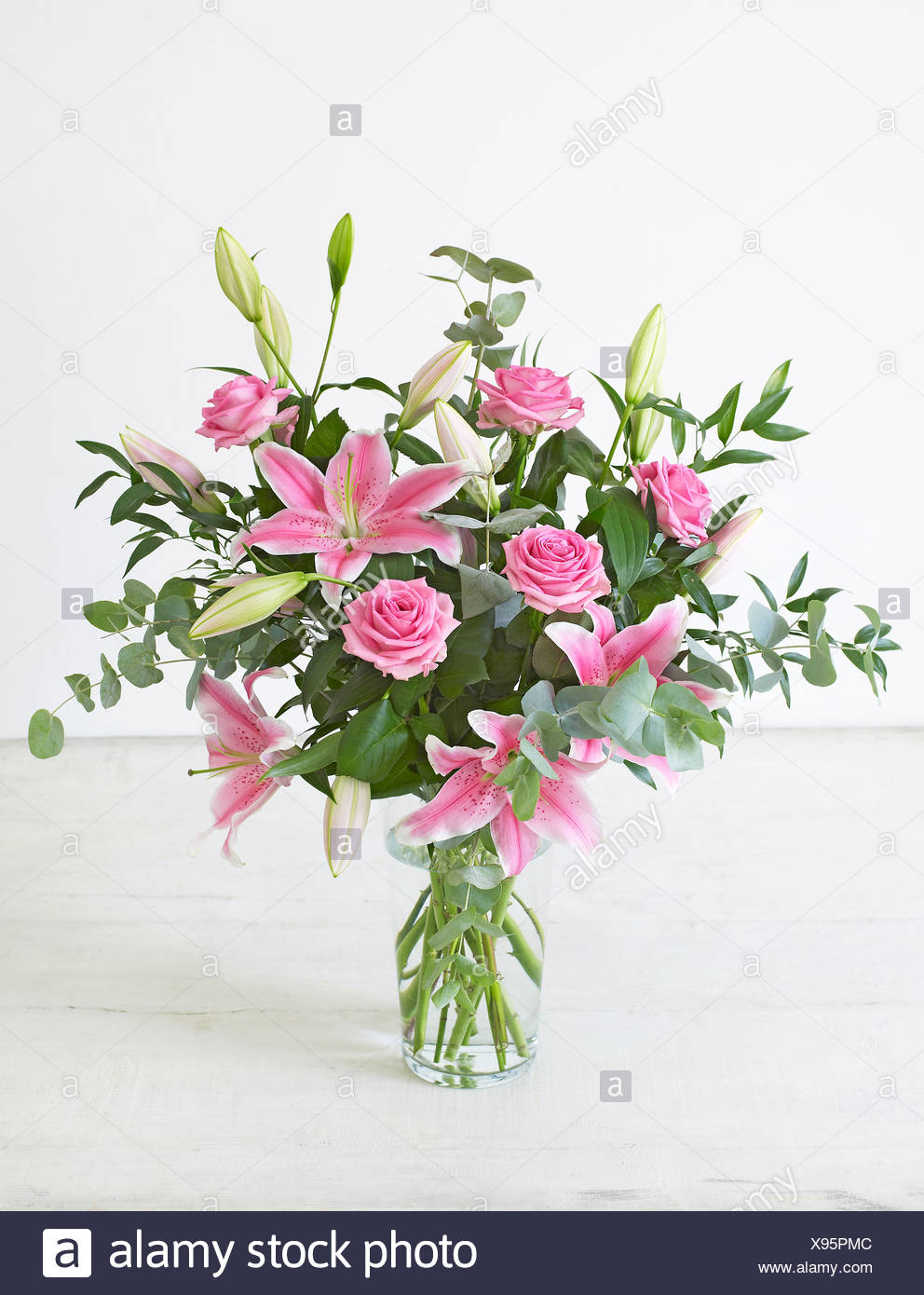 Lily rose stock photos lily rose stock images alamy vase container bouquet of flowers including eucalyptus lily rose close up izmirmasajfo
