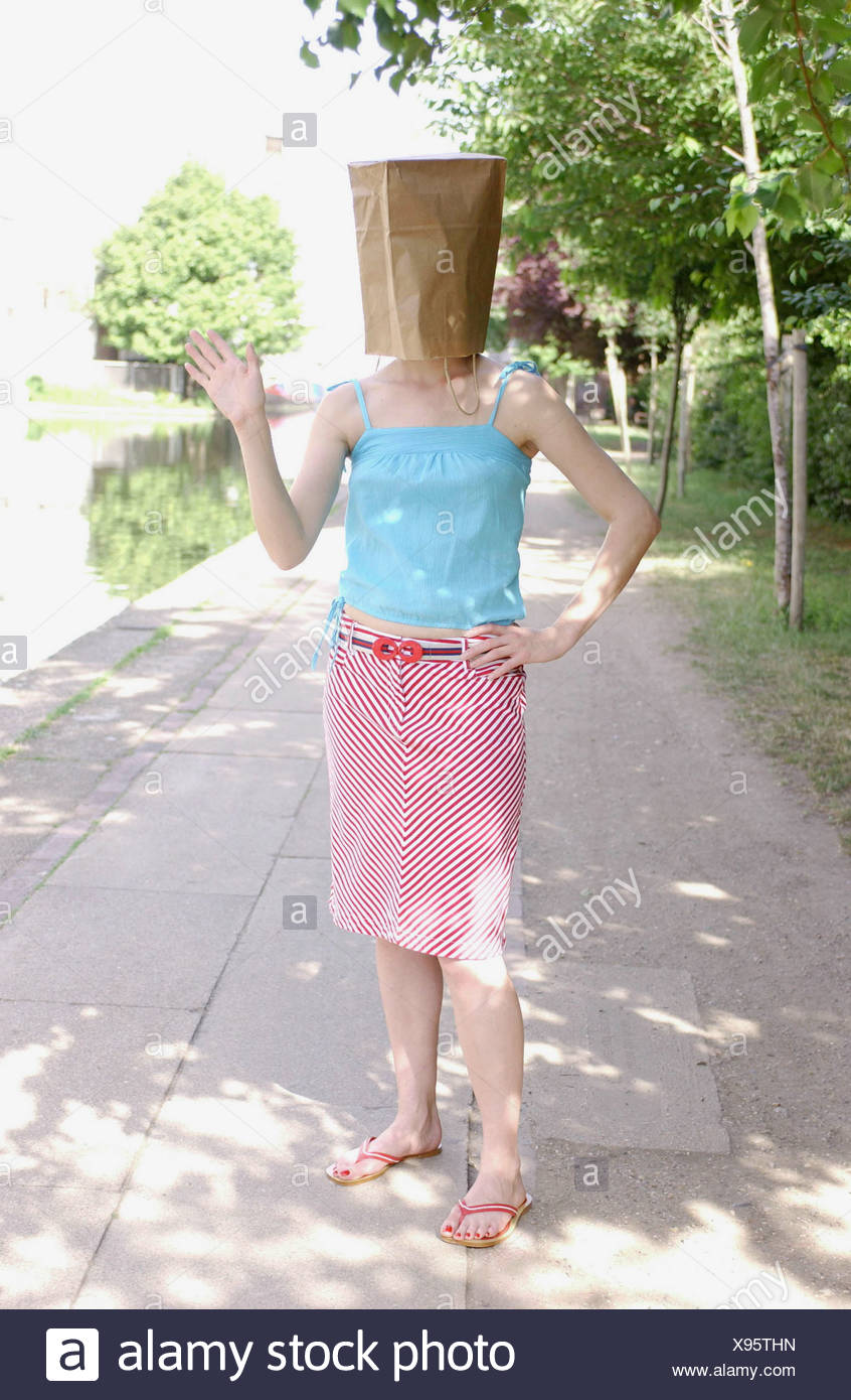 8027f773e4d7f Female wearing turquoise blue vest top red and white diagonal striped knee  length skirt and red