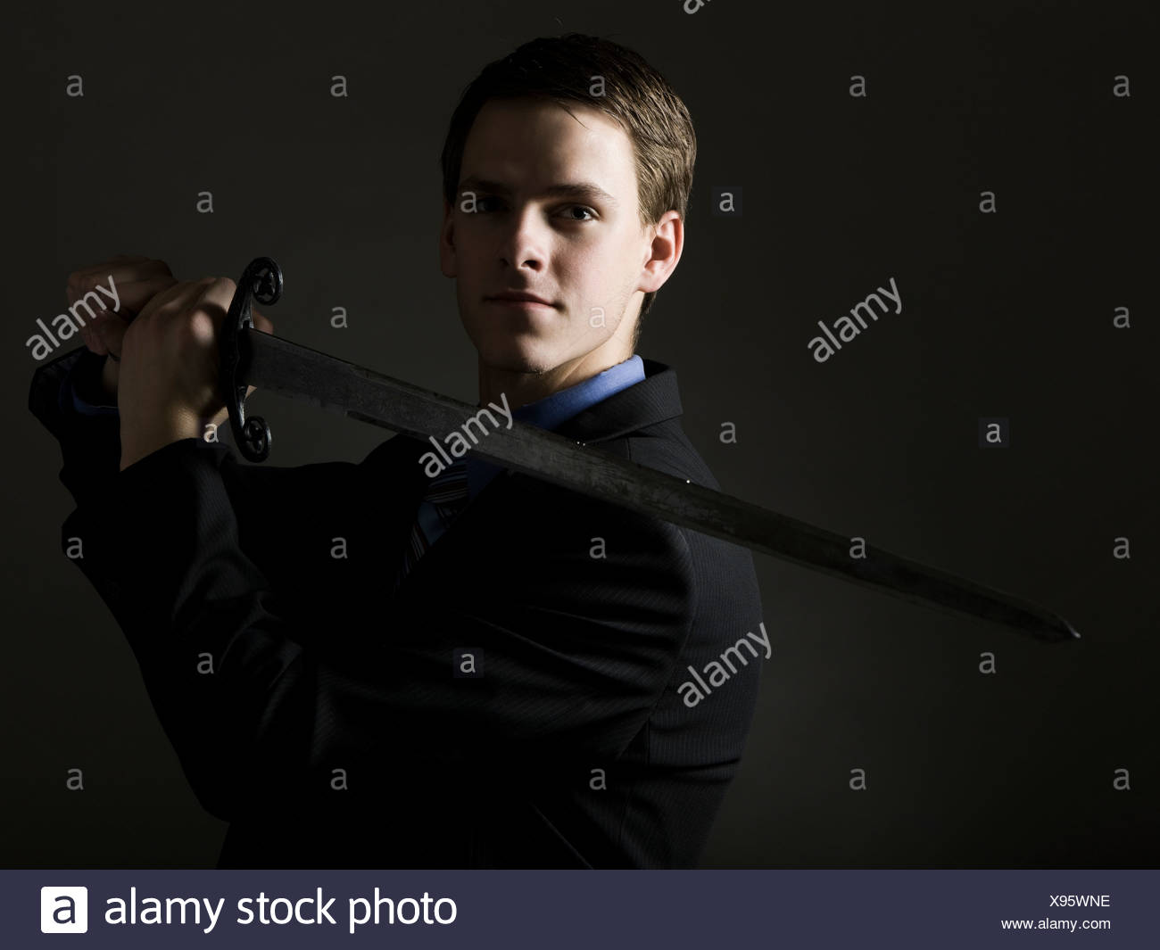 businessman holding a sword - Stock Image