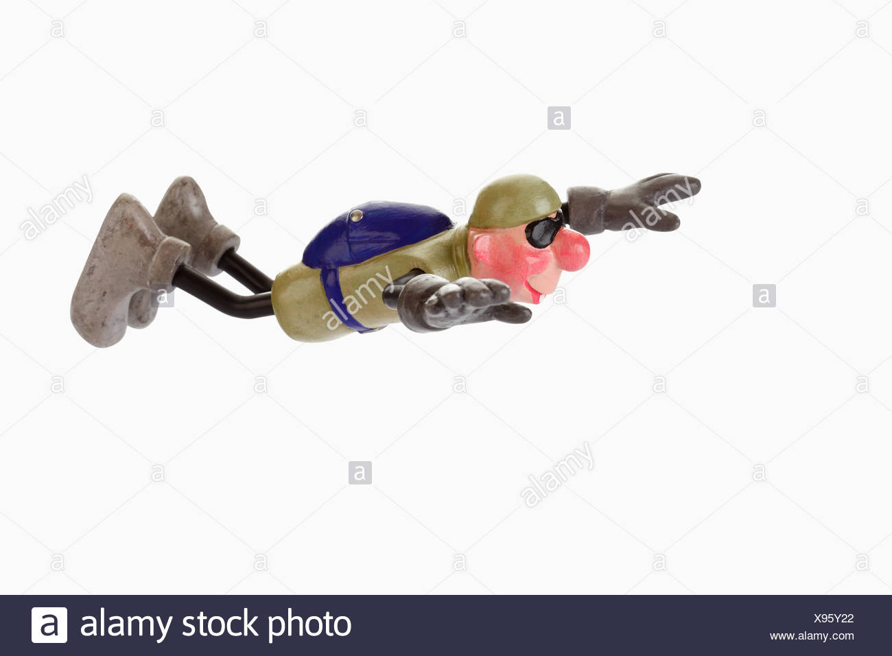Cartoon character, basejumper in gliding flight - Stock Image