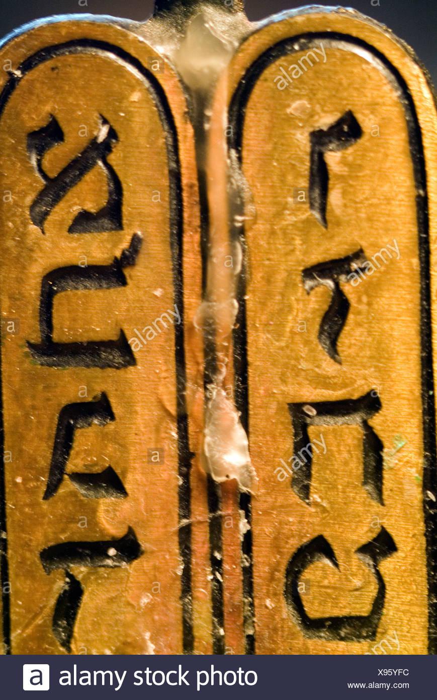 Close-up of Hebrew script on a menorah - Stock Image