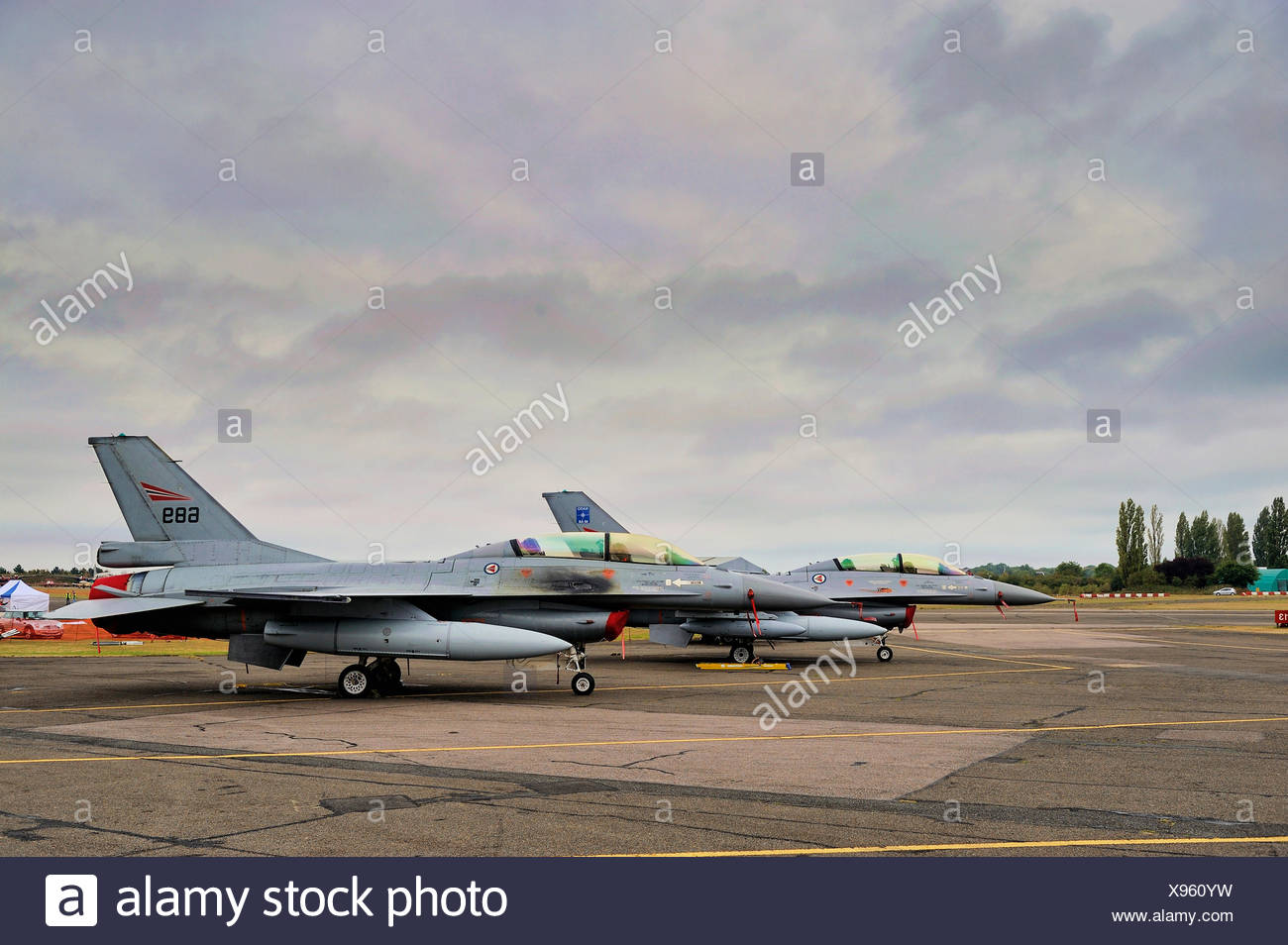 Two Norwegian Air Force General Dynamics F-16s at North Weald Airfield, Essex, England, United Kingdom, Europe - Stock Image