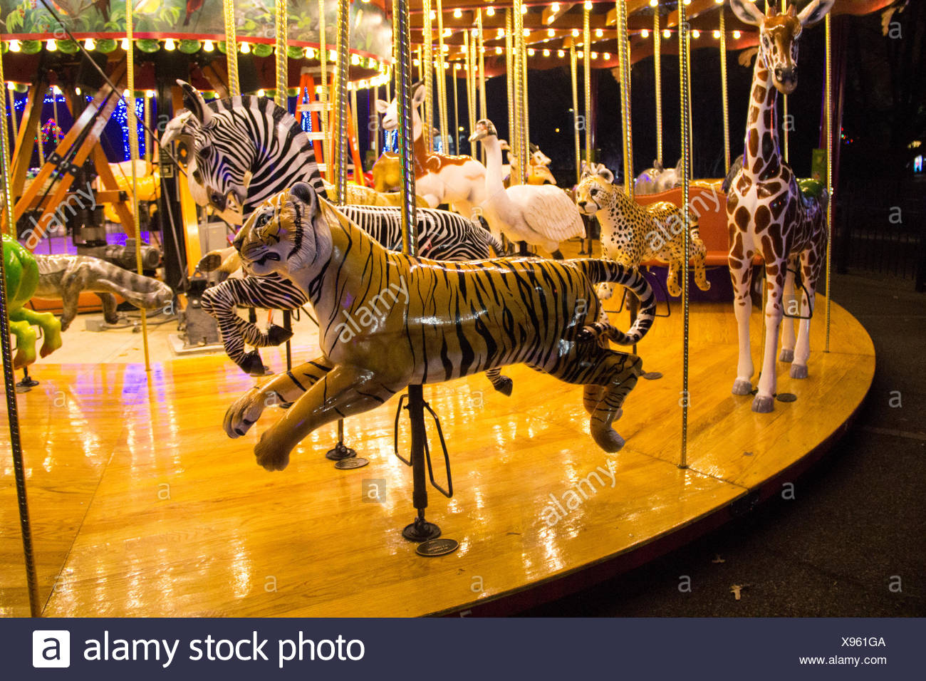 The Zoo's carousel is a varied menagerie of colorful animals. - Stock Image