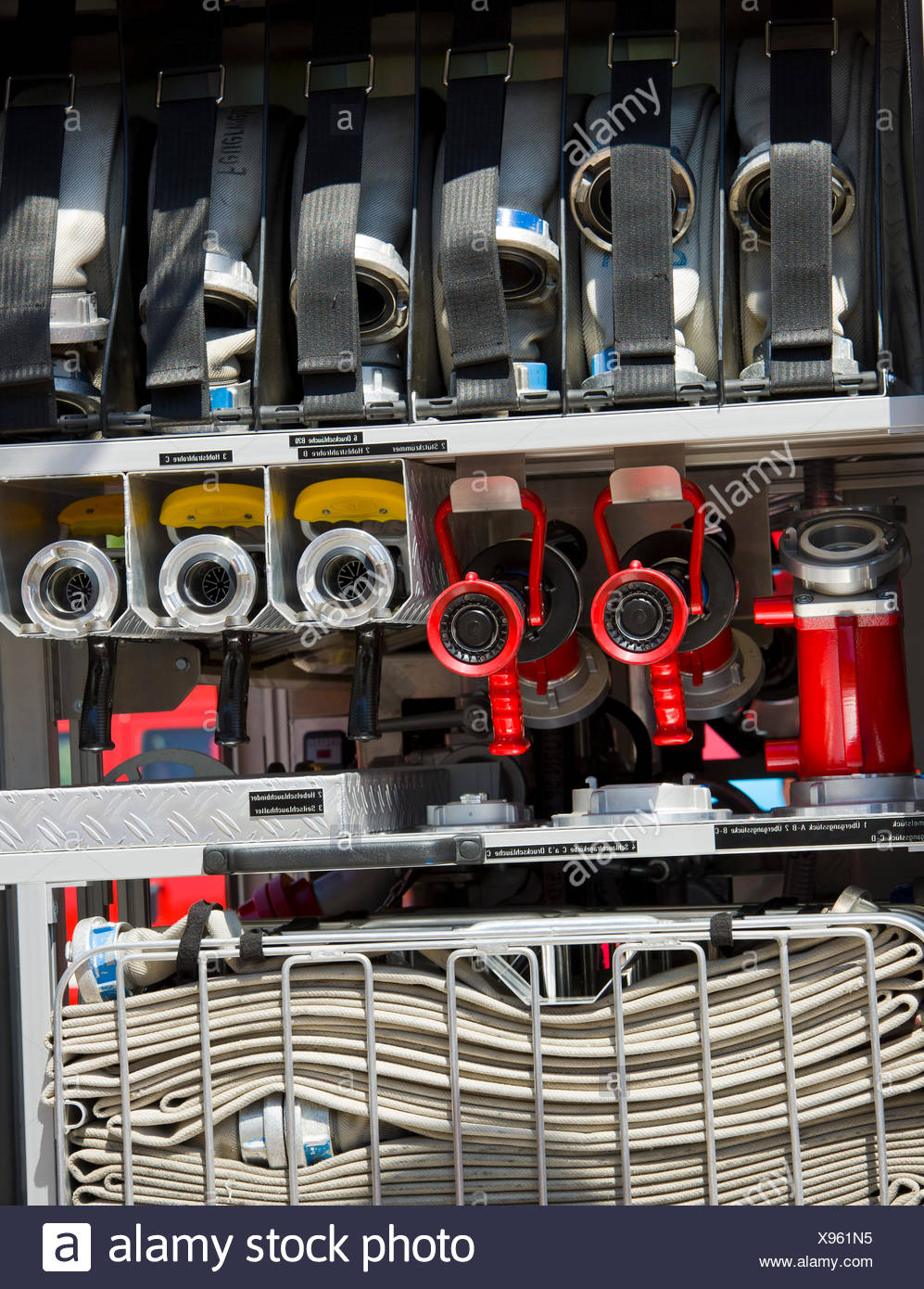 Fire engine hoses and nozzles. Stock Photo