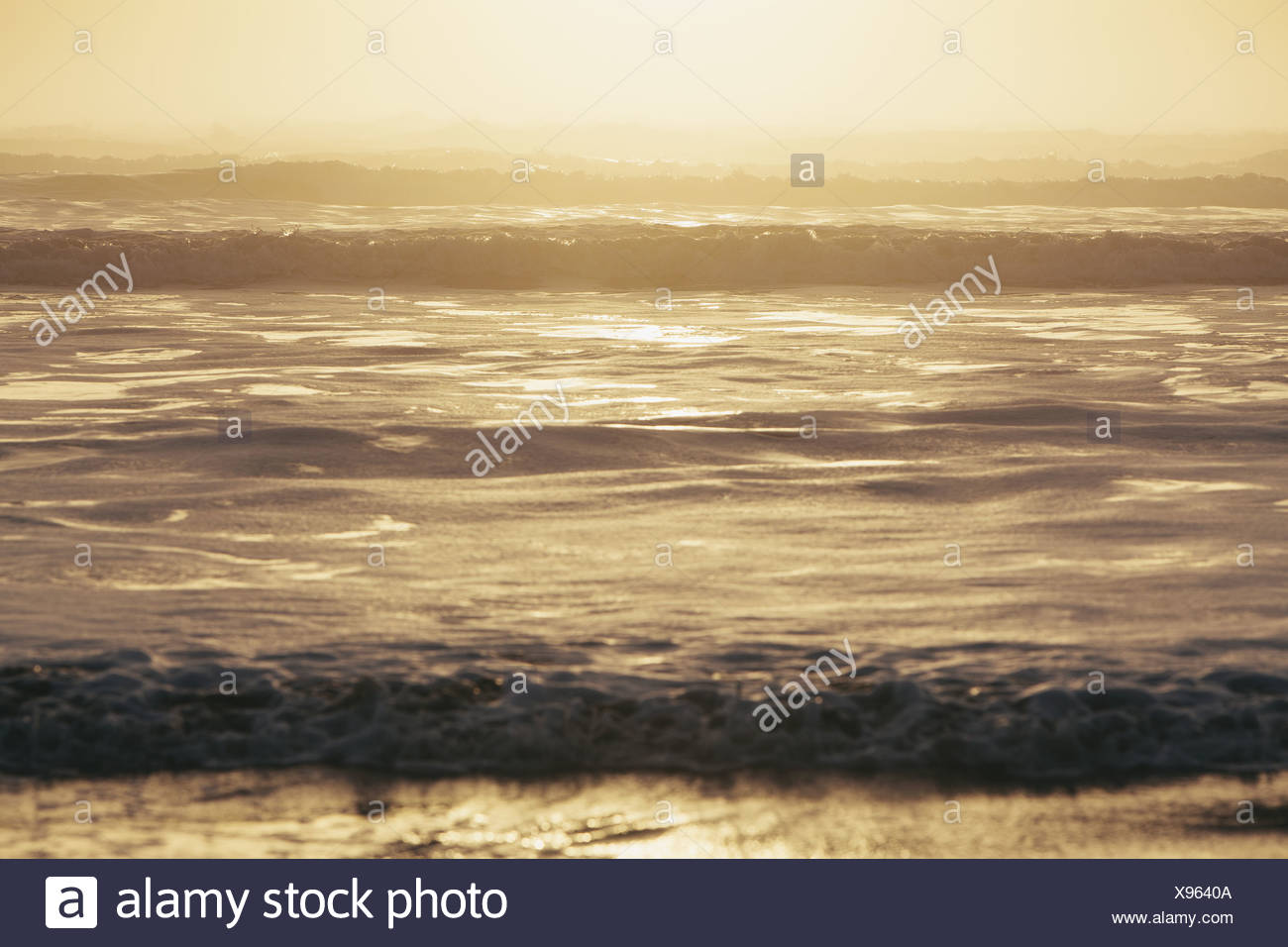 Seascape at dusk, Waves breaking on the shore. Tidal zone. Off the shores of the Olympic National park, in Washington, USA - Stock Image