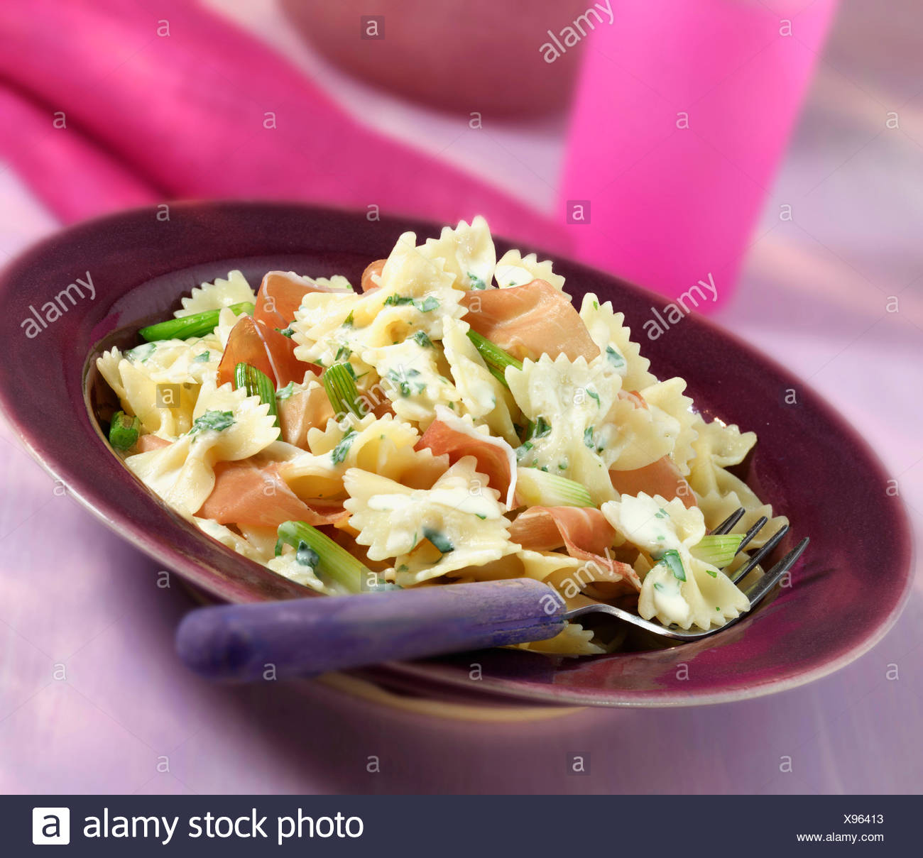 Plate Of Homemade Farfalle With Ham And Onion - Stock Image