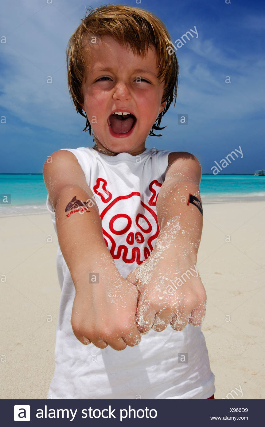 Child on the beach in Laguna Resort, The Maldives, Indian Ocean - Stock Image