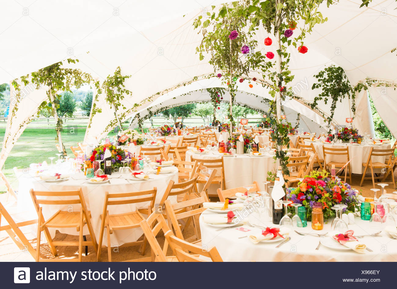 Decorated Tables In Garden Marquee At Wedding Reception Stock Photo
