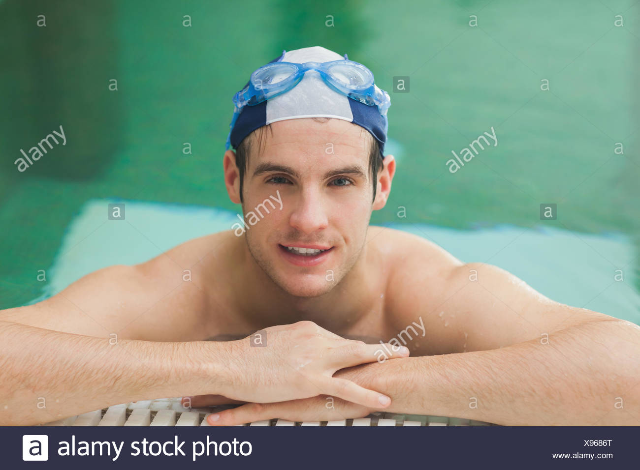 Happy man in the swimming pool Stock Photo